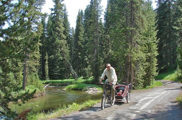 Henry on bike with bike trailer