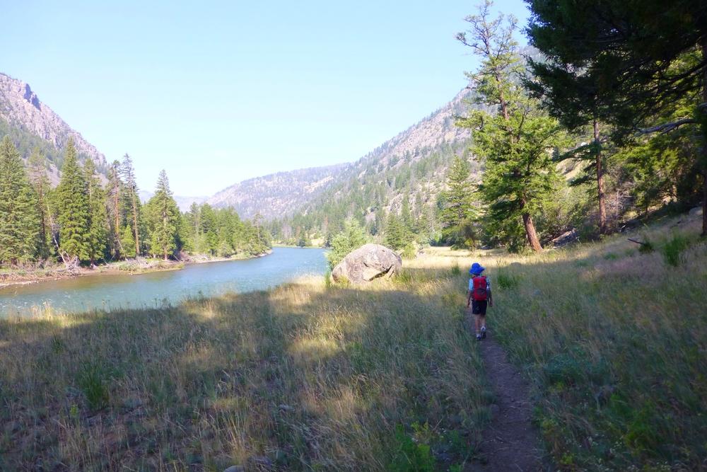 Walking down trail next river