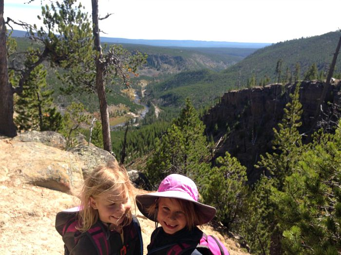 Cute girls to the front and canyon views to the south on the Monument Geyser Basin Trail.